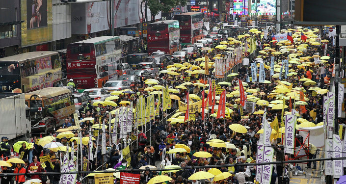 Thousands of activists take part in a democracy march to Central, demanding for universal suffrage in Hong Kong Sunday, Feb. 1, 2015