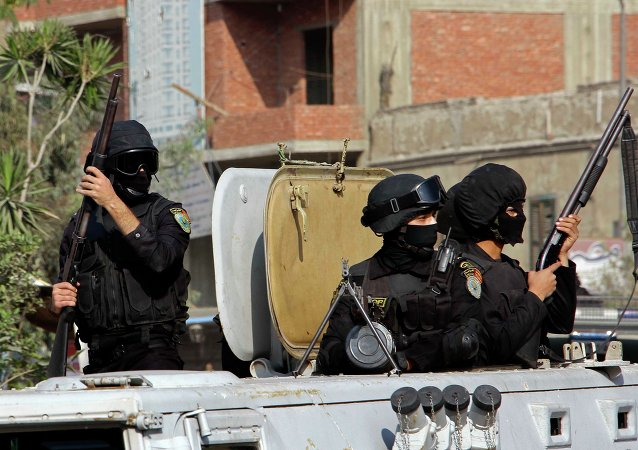 Masked Egyptian security forces deploy in the Cairo suburb of Matareya