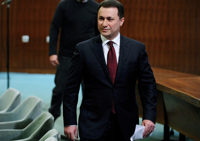 Macedonian Prime Minister Nikola Gruevski walks after a news conference at the government building in Skopje, Macedonia