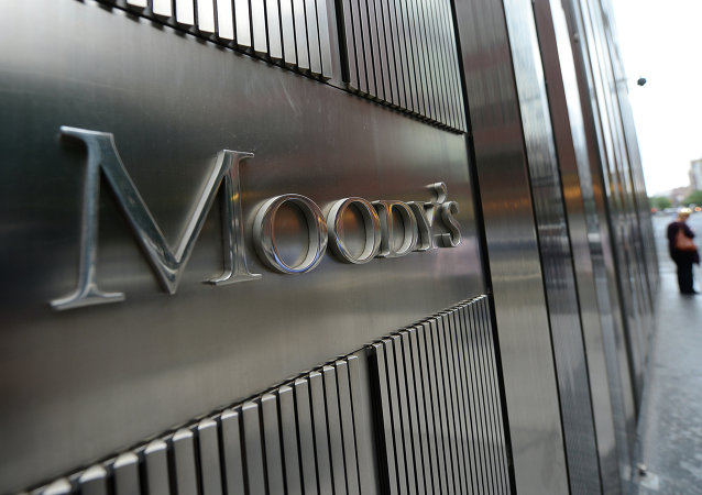 A sign for Moody's rating agency stands in front of the company headquarters in New York.
