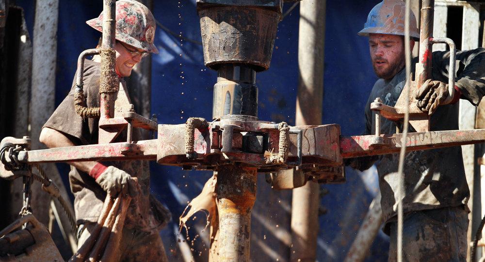 Oil field workers drill into the Gypsum Hills near Medicine Lodge, Kansas