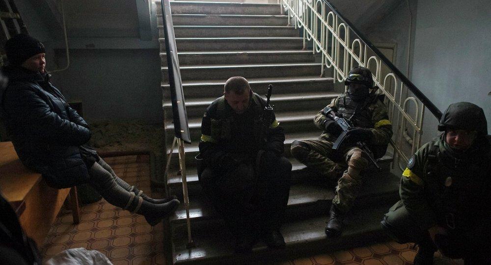 Members of the Ukrainian armed forces gather inside a school building in Debaltseve