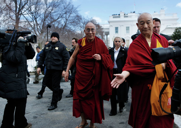 The Dalai Lama leaves the White House in Washington, Thursday, Feb. 18, 2010, following a meeting with President Barack Obama.