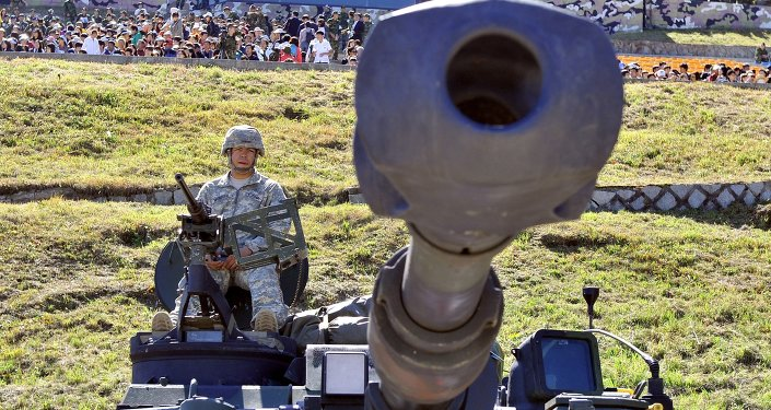 A US soldier sits on the top of M109A6 Paladin 155mm Howitzer during a joint military exercise on the Seungjin Fire Training Field in Pocheon, 30 kms south of the border with North Korea . File photo