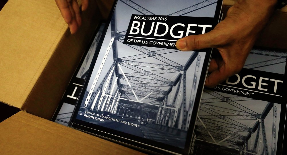 Copies of President Barack Obama's proposed 2016 budget are unboxed for sale at the Government Printing Office in Washington February 2, 2015