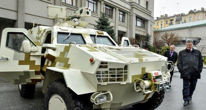 Ukraine's President Petro Poroshenko inspects an armoured vehicle in Kiev