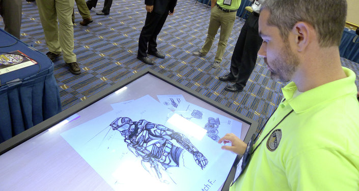 Sketches of the body armor exoskeleton during the Special Operations Forces Industry Conference in Tampa