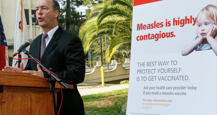 Los Angeles County Department of Public Health Interim Health Officer Dr. Jeffrey Gunzenhauser speaks about the state's measles outbreak during a news conference.