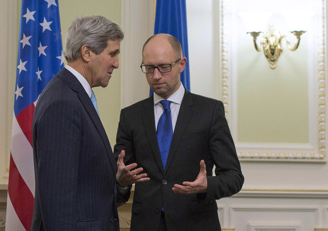 US Secretary of State John Kerry (L) talks with Ukrainian Prime Minister Arseniy Yatsenyuk