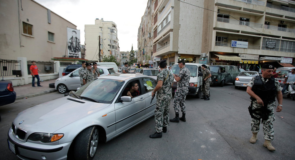 Lebanese security forces man a checkpoint in the southern suburb of the capital Beirut