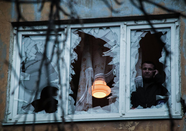 A man in a building damaged by shelling on Panfilova Prospect in Donetsk.