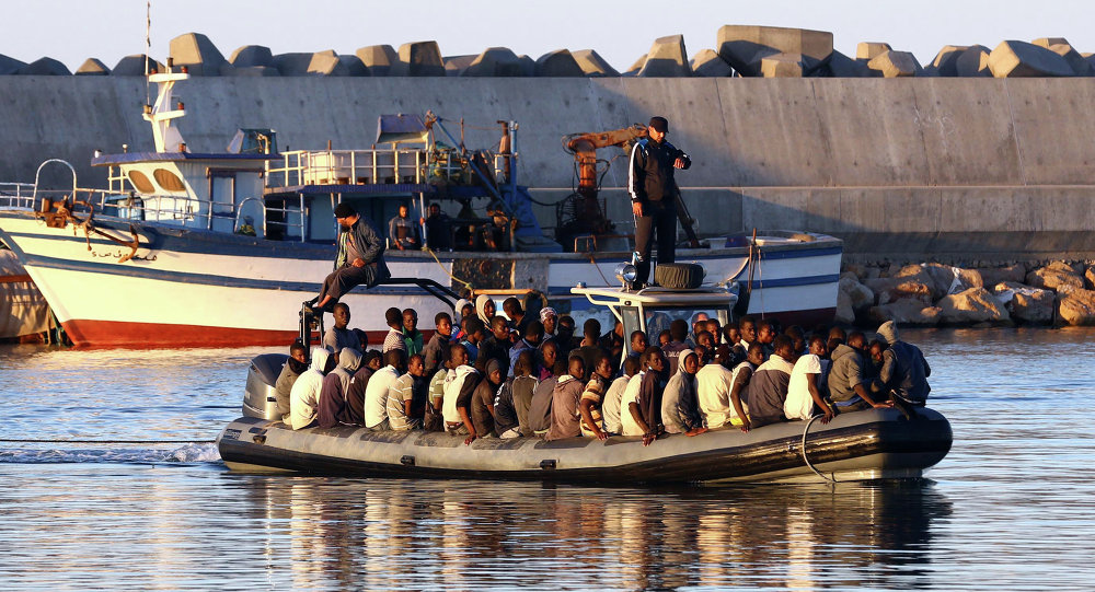 Sub-Saharan African migrants are rescued by the Libyan coastguard after their inflatable boat started to sink off the coastal town of Guarabouli. File photo