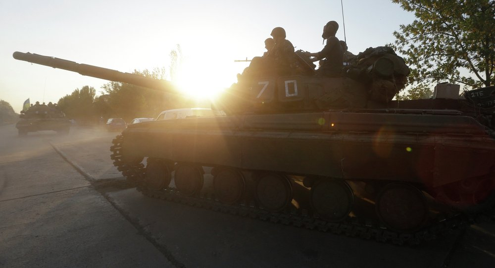 Soldiers of Ukrainian army ride on tanks