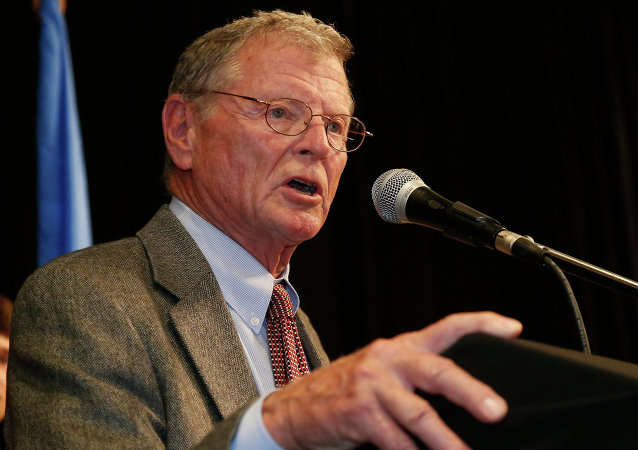 Senator Jim Inhofe, R-Oklahoma, gestures during his victory speech at the Republican watch party in Oklahoma City, Tuesday, Nov. 4, 2014