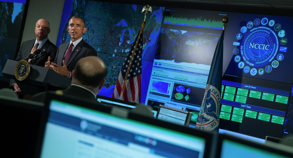 Homeland Security Secretary Jeh Johnson listens at left as President Barack Obama speaks at the National Cybersecurity and Communications Integration Center in Arlington, Va., Tuesday, Jan. 13, 2015