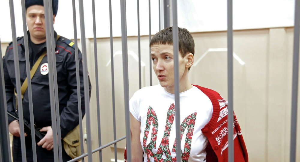 Ukrainian army pilot Nadezhda (Nadia) Savchenko looks out from a defendant's cage during a hearing at the Basmanny district court in Moscow February 10, 2015