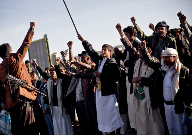 Houthi Shiite Yemenis chant slogans during a rally in Sanaa, Yemen, Wednesday, January 28, 2015.