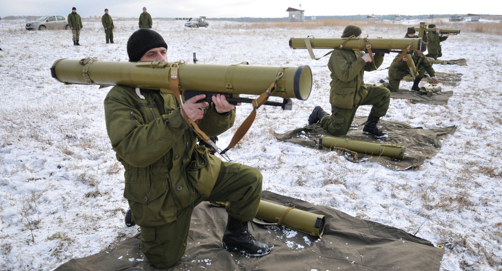 Ukrainian army soldiers perform a weapons exercise at a training ground outside Lviv, western Ukraine, Thursday, Feb. 5, 2015