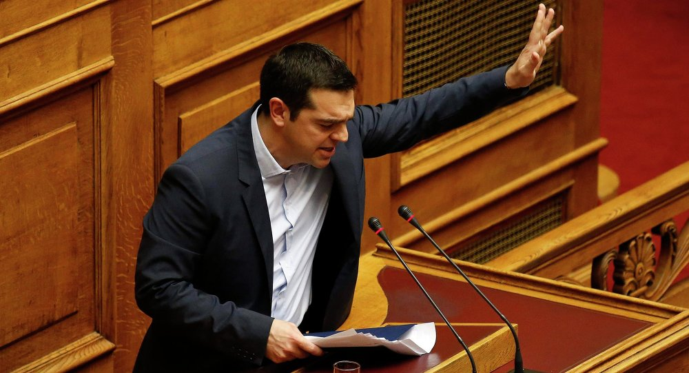 Greek Prime Minister Alexis Tsipras waves to lawmakers following his first major speech in parliament in Athens February 8, 2015