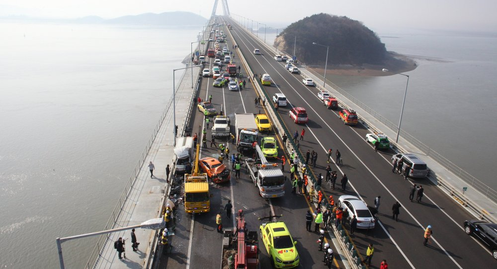 This general view shows a multiple collision that occurred in heavy fog on the Seoul-bound lane (L) of a bridge forming part of the main expressway linking Incheon airport, west of Seoul,