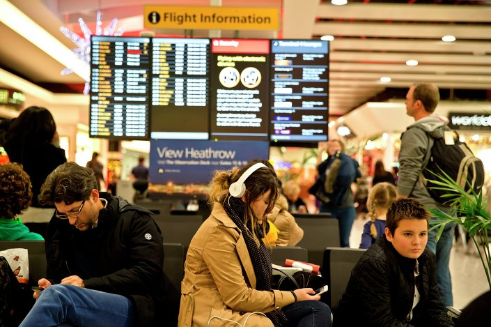 Passengers wait at Heathrow Airport in London.