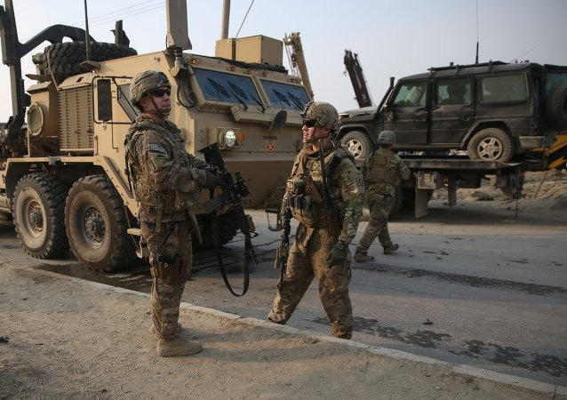 U.S. and British soldiers chat at the site of a suicide attack in Kabul, Afghanistan in January.