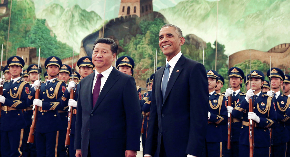 US President Barack Obama stands next to Chinese President Xi Jinping at the Great Hall of the People in Beijing, China.