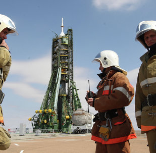 Russian Emergency Situations Ministry staff provide security on the launch pad before launch of the Soyuz TMA-21 Gagarin at the Baikonur Cosmodrome