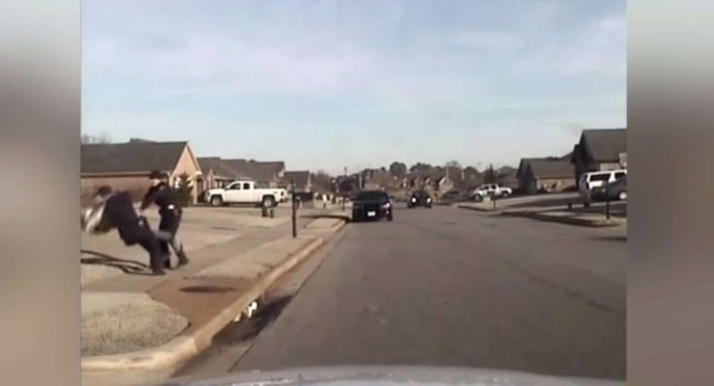 """In the two dashcam videos released by the police department one officer can be heard telling the other, """"He's saying 'No English'"""", then continuing to question Patel before slamming him to the ground."""