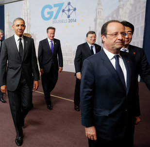 US President Barack Obama, third left, walks with, from left to right: Italian Prime Minister Matteo Renzi; Canadian Prime Minister Stephen Harper; British Prime Minister David Cameron; European Commission President Jose Manuel Barroso; French President Francois Hollande; Japanese Prime Minister Shinzo Abe; after a G7 group photo