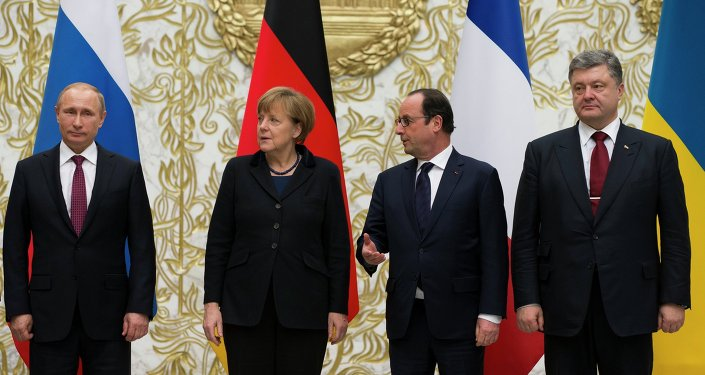 From the left : Russian President Vladimir Putin, German Chancellor Angela Merkel, French President Francois Hollande, and Ukrainian President Petro Poroshenko pose for a photo during a time-break in their peace talks in Minsk, Belarus, Wednesday, Feb. 11, 2015