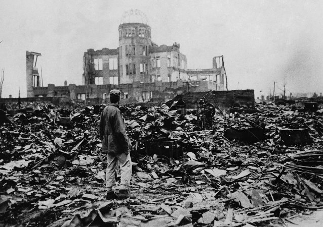 A man looks over the expanse of ruins left the explosion of the atomic bomb on August 6, 1945 in Hiroshima, Japan