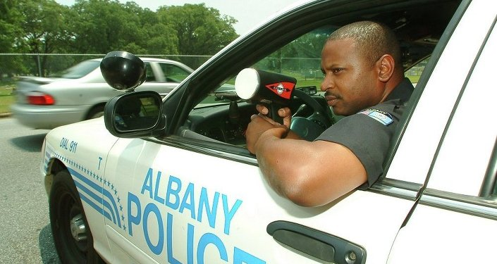 Albany police Cpl. Robert Ponder clocks traffic on a south Albany, Ga. street, Thursday, June 23, 2005, in Albany, Ga. Ponder