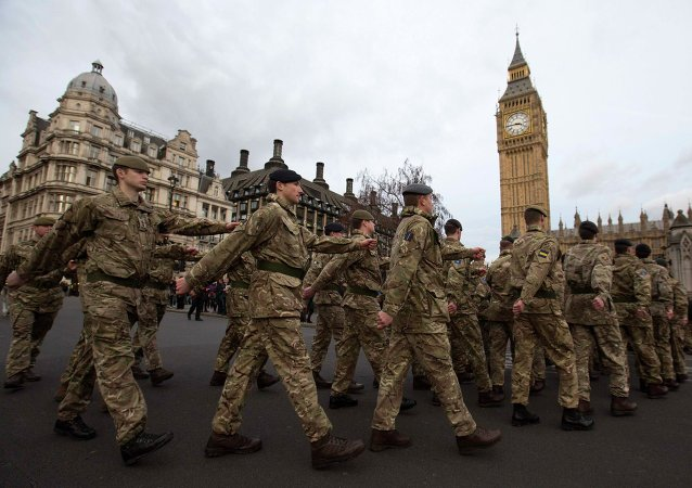 Members of Britain's armed forces march from Wellington Barracks to The Houses of Parliament.