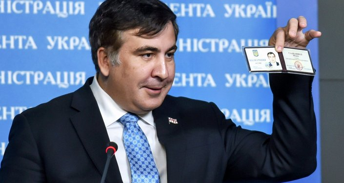 Former Georgia's President Mikheil Saakashvili shows off his identification card as the head of an advisory council in Kiev, in this February 17, 2015 handout photo supplied by the Ukrainian Presidential Press Service