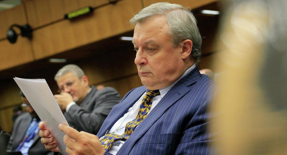 Russia's ambassador to the International Atomic Energy Agency (IAEA) Grigory Berdennikov reads documents