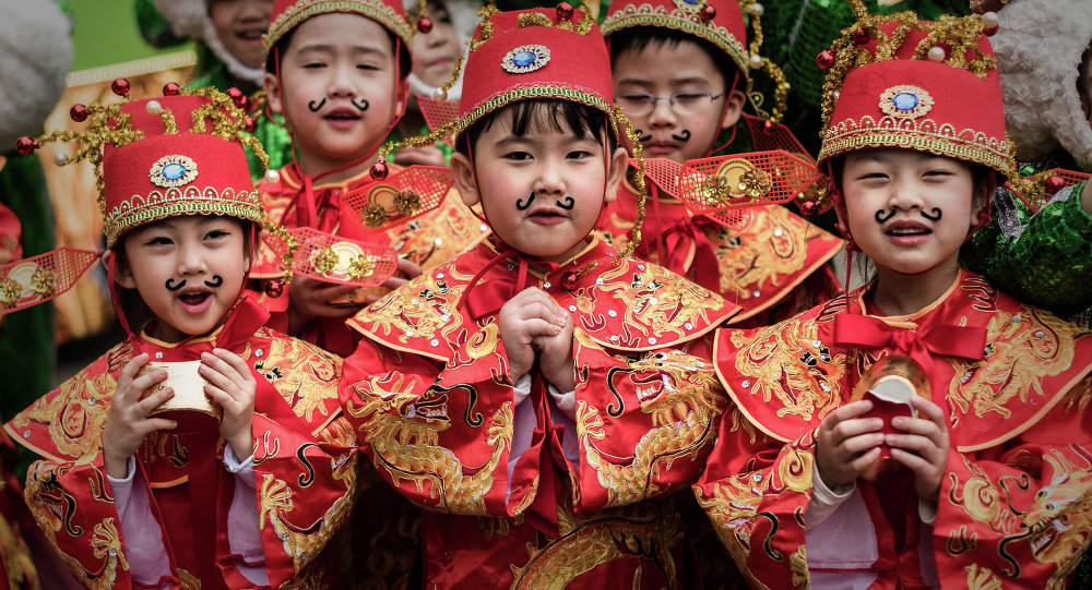 Children wearing traditional costumes pose during preparations for Chinese lunar new year celebrations in Hong Kong