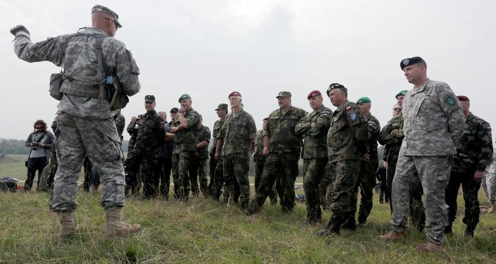 Soldiers from NATO countries take part in a battle conducted exercise