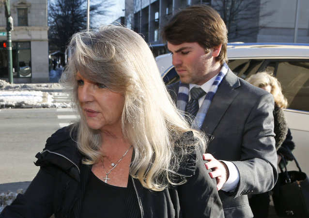 Former First Lady Maureen McDonnell, left, arrives at federal court with her son, Bobby, for her sentencing on corruption charges in Richmond, Va., Friday, Feb. 20, 2015. Federal prosecutors have recommended an 18-month prison term, six months less than former Gov. Bob McDonnell received when he was convicted on 11 counts last month.
