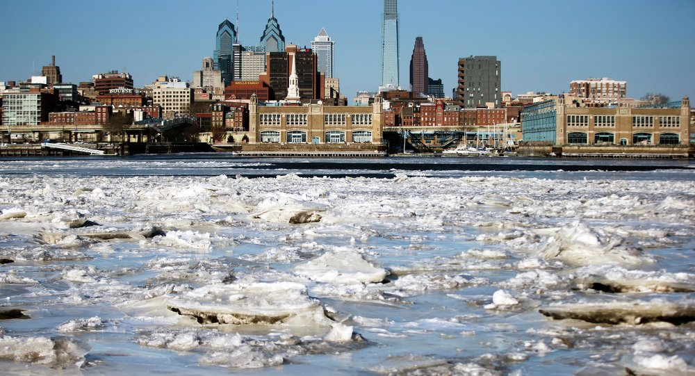Ice collects on the Delaware River in view of Philadelphia.