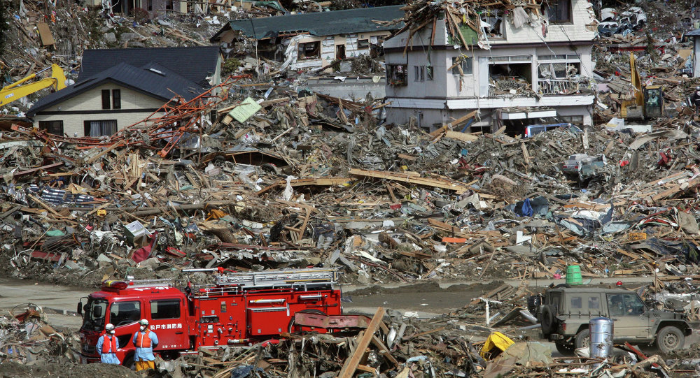 Fire fighters search for survivors following the March 11 earthquake and tsunami in Rikuzentakata, Iwate prefecture, northeastern Japan, Friday, March 18, 2011. (File)