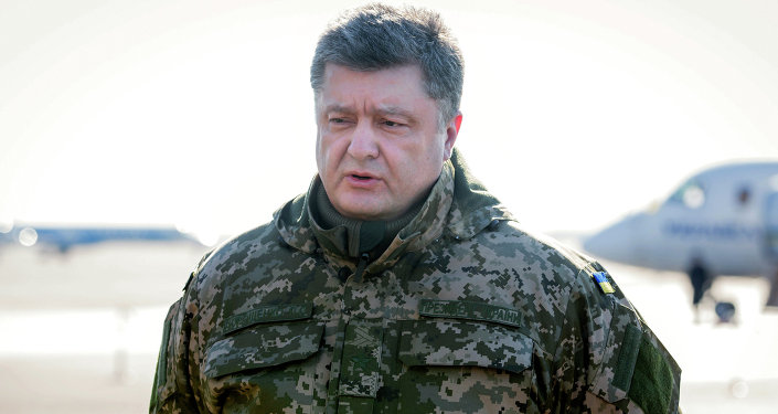 Ukrainian President Petro Poroshenko makes a press statement before his flight to the military operation area