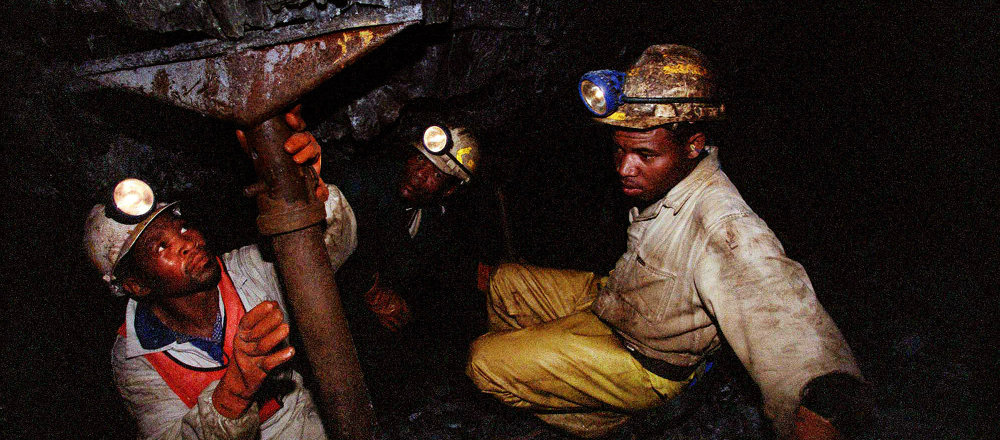Miners work underground at the Harmony Goldmine, near Carletonville, South Africa, in this Wednesday Oct. 27, 2004 file photo. Some 3,000 miners were trapped underground when a water pipe burst and probably caused a shaft to collapse Wednesday, Oct. 3, 2007, in Harmony Gold's Elandsrand Mine near Johannesburg, South Africa's economic capital and gold-mining center