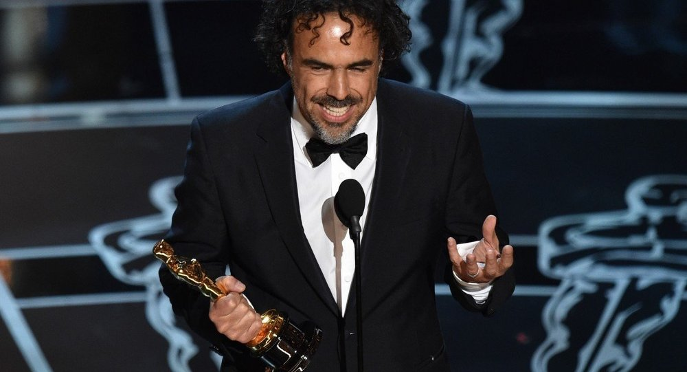 Alejandro G. Inarritu accepts the award for best director for Birdman or (The Unexpected Virtue of Ignorance) at the Oscars on Sunday, Feb. 22, 2015, at the Dolby Theatre in Los Angeles