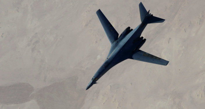 B-1B Lancer disengages from a KC-135 Stratotanker after refueling after airstrikes on Islamic State jihadists in Syria