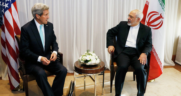 U.S. Secretary of State John Kerry, left, waits with Iranian Foreign Minister Mohammad Javad Zarif before a meeting in Geneva.
