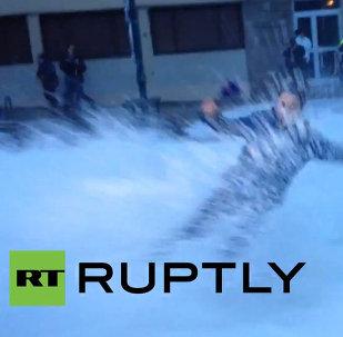 Huge Wave Sweeps Reporter During a Live Broadcast