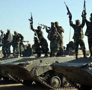 Chadian troops gather on February 1, 2015 near the Nigerian town of Gamboru, just accros the border from Cameroon