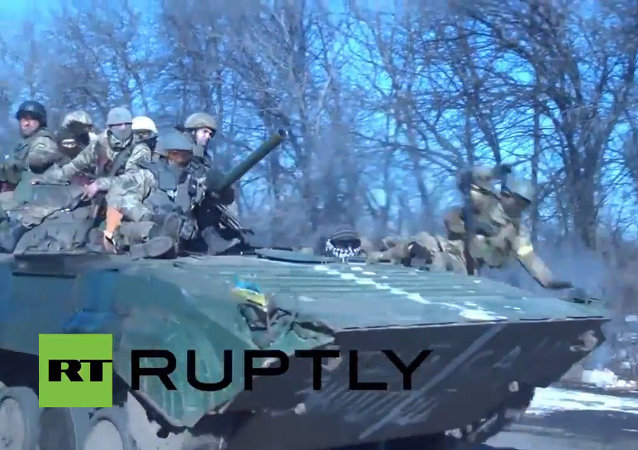 Ukrainian Soldier Falls Off Combat Vehicle During Troops Withdrawal