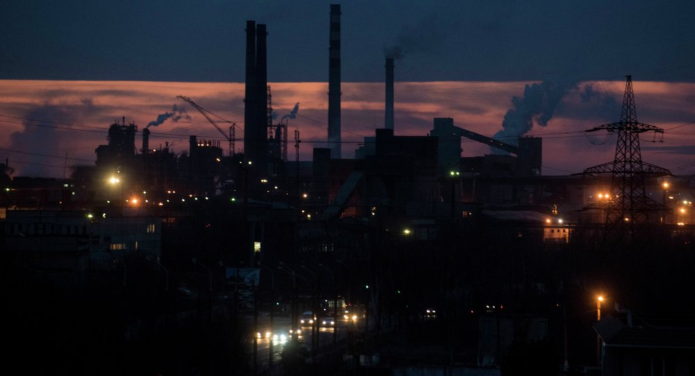 Smoke rises over the Azovstal steel factory in the sunset in Mariupol, eastern Ukraine, Wednesday, Feb. 25, 2015